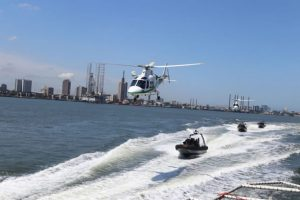 helicopter and ships moving